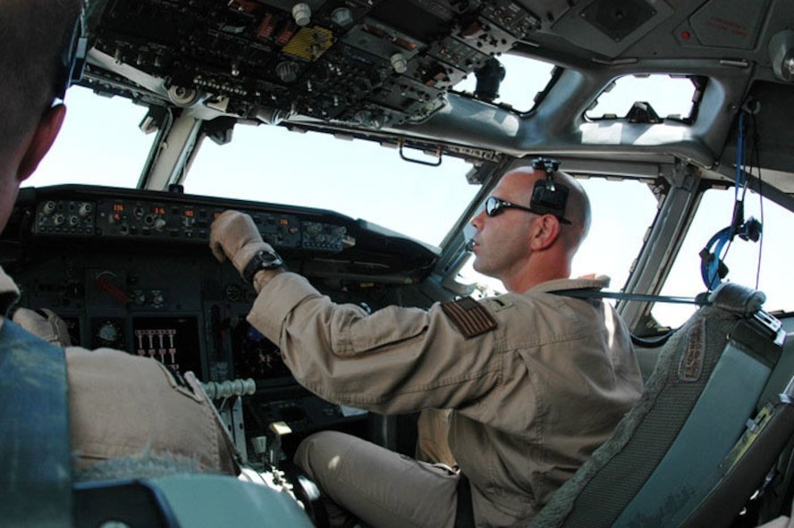 Navy Lt j.g. Nathan Lassas enters information into the autopilot computer in July in Southwest Asia. Lieutenant Lassas, assigned to Task Force 124, pilots an E-6B Mercury over Iraq which helps Soldiers communicate on the ground. (U.S. Air Force photo/Staff Sgt. Cassandra Locke)