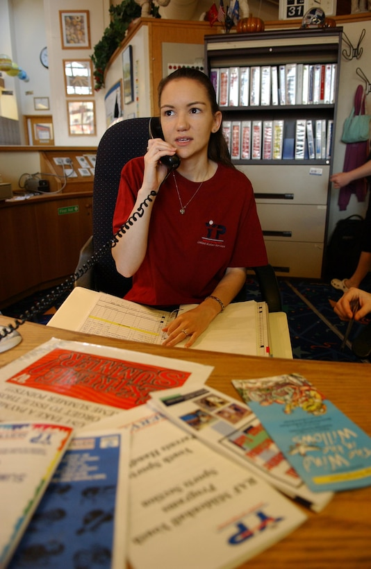 Michelle Ackley performs her daily duties as a Desk Clerk at the RAF Mildenhall Youth Center. (U.S. Air Force photo by Staff Sgt. Tyrona Pearsall)