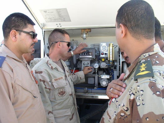 Tech Sgt. Randy Davidson, a deployed instructor with the 366th Training Squadron Fues Flight, shows the first class of Iraqi fuels students a piece of fuels equipment. (U.S. Air Force photo)