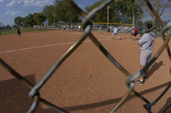 A member of the Civil Engineer Softball Team takes a swing during the Aug. 6, Hill Air Force Base Intramural Competition League Championship Game against Ammo. The CE Team, which advanced from the loser's bracket, won the first game 14-11.  The Ammo Team won the second game 26-24 securing the championship for Ammo. Members of the Ammo Team are looking forward to competing in a Layton, Utah, Community League in the fall. (Photo by Airman 1st Class Clay Murray)