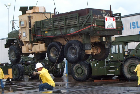 A longshoreman unloads the gun truck at the Port of Beaumont, Texas, April 21, 2006. The truck is now on exhibit at the Enlisted Heritage Hall at Maxwell Air Force Base's Gunther Annex, Ala. (Official U.S Air Force photo)(released)