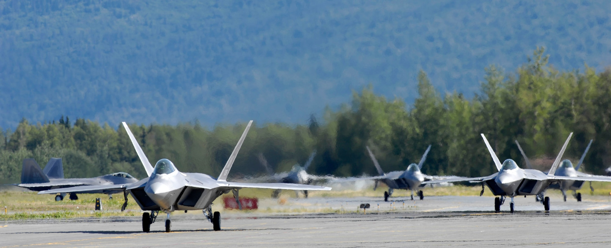 Six F-22 Raptors taxi following touchdown at Elmendorf Air Force Base, Alaska, during a ceremony marking the aircraft's arrival Aug. 8. The F-22s will join the active duty 3rd Wing and Air Force Reserve Command's 477th Fighter Group here. The 477th FG becomes the first Air Force Reserve unit to operate and maintain the F-22. (U.S. Air Force photo/Tech. Sgt. Keith Brown)