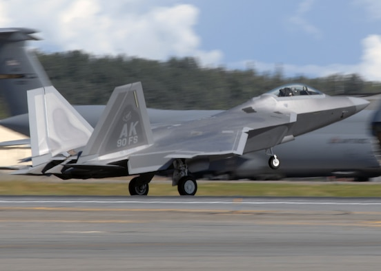 Elmendorf Air Force Base, Alaska -- The first of 40 F-22A Raptors lands during an arrival ceremony here Wednesday. The aircraft, which will be flown and maintained by the active-duty Air Force's 90th Fighter Squadron and Air Force Reserve 302nd Fighter Squadron, is the first to be permanently base outside of the contiguous United States. (U.S. Air Force photo by Airman 1st Class Laura Turner)