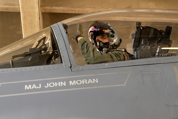 F-15 Eagle pilot 1st Lt. John Fischer waves before taking off from Kadena Air Base, Japan, Aug. 5 to fly to Guam. He will be one of more than 22,000 servicemembers taking part in the joint exercise Valiant Shield which runs through Aug. 14. Lieutenant Fischer is from the 44th Fighter Squadron. (U.S. Air Force photo/Airman 1st Class Kelly Timney)