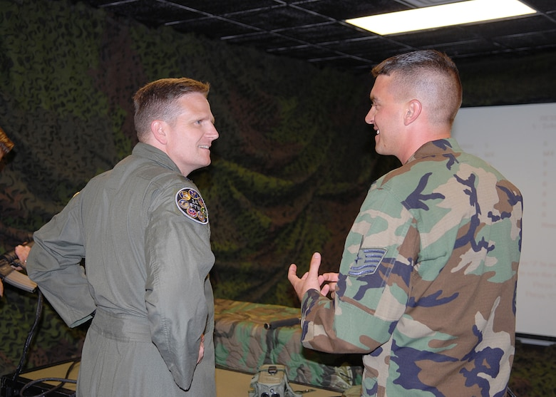Colonel Jeff Dunn, 14th Flying Training Wing vice commander, talks with Tech. Sgt. James Robertson, 14th Security Forces Squadron, during his immersion Aug. 2. (U.S. Air Force Photo by Elizabeth Owens)