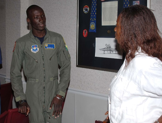 Second Lt. Sidi Diallo, Specialized Undergraduate Pilot Training Class 07-15 and an international student pilot from Mali, talks to a Fulbright Scholar Tuesday during a tour. The Fulbright Scholars toured Columbus AFB to to gain insight on the pilot training that takes place here. (U.S. Air Force Photo by Airman 1st Class Danielle Powell)