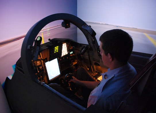 Cadet Master Sgt. Ryan Lowe, Plano Mustangs Composite Civil Air Patrol Squadron, tries out a T-38 simulator while tourning Sheppard with his CAP squadron July 25. (U.S. Air Force photo/Airman 1st Class Jacob Corbin)
