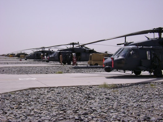 Three 33rd Rescue Squadron HH-60 Pave Hawks await mission taskings at Kandahar, Afghanistan.  The 33rd RQS from Kadena Air Base, Japan, deployed the end of July to Kandahar to conduct combat search and rescue and medical rescue missions in support of Operation Enduring Freedom. The squadron headed back to Afghanistan after returning from a four-month deployment to Kandahar in May.  U.S. Air Force photo