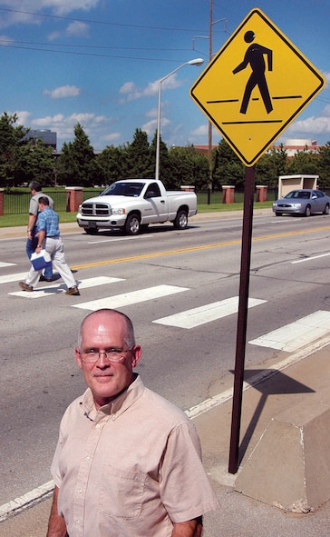Heavy traffic and lots of pedestrians used to be a recipe for danger; something worker Lewis Haddock knew needed changing. His focus on the problem and suggestions led base officials to name him the first Safety Hero. Better signs, lighting and channeling of pedestrian traffic are some changes making the area safer. (Air Force photo by Margo Wright)