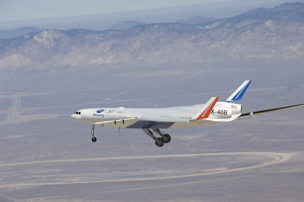 The X-48B Blended Wing Body research vehicle, on its maiden flight at the NASA Dryden Flight Research Center.  (Photo courtesy Boeing)