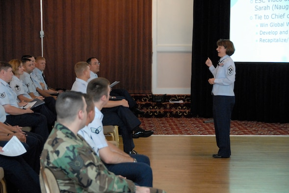 66th Air Base Wing and Electronic Systems Center Command Chief Master Sgt. Lisa Sirois, right, informs Hanscom's enlisted population about current Air Force hot topics during an enlisted call at the Minuteman Club July 31. (U.S. Air Force photo by Senior Airman Clinton Atkins.)