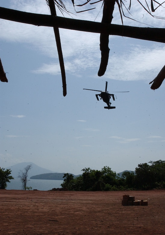 A UH-60 Black Hawk from the 1st Battalion, 228th Aviation Regiment prepares to land in a soccer field in Coyolito, Honduras to pick up humanitarian supplies for Project Handclasp. Project Handclasp is a partnership between the Navy and corporations, public service organizations, non-government organizations and individuals throughout the United States to provide humanitarian assistance overseas. Members of Joint Task Force-Bravo, at Soto Cano Air Base, provided air, ground and logistical support for the mission. Air Force photo by Senior Airman Shaun Emery.