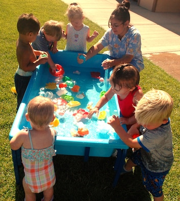 SCHRIEVER AIR FORCE BASE, Colo. -- Children at the Child Development Center have some fun in the sun, and water, during Water Fun Day on August 10. (U.S. Air Force photo/Lorna Gutierrez)