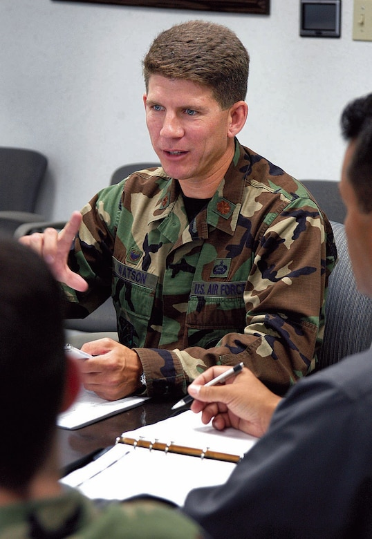 Maj. Aaron Watson, 5th Manpower Requirements Squadron commander, leads a recent staff meeting.  (Air Force photo by Margo Wright)