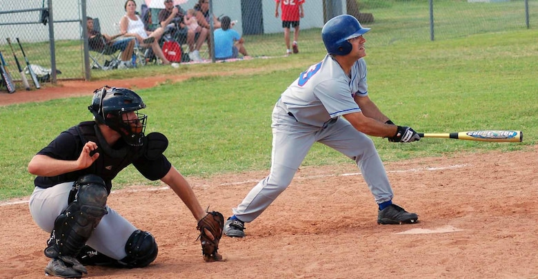 Tinker Rangers utility player John Scherer takes a swing against the Sooners in a game played Aug. 5. (Air Force photo by John E. Banks)