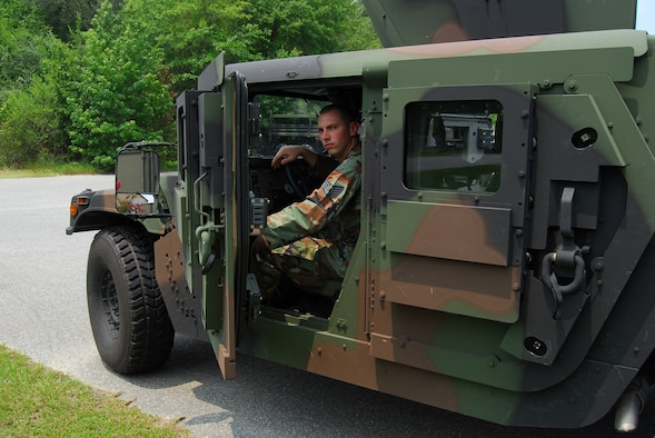 Staff Sgt. Tim Bele, 820th Security Forces Group vehicle maintenance craftsman, performs a daily inspection of one of the 820th SFG's armored Humvees equipped with frag 5 armor Aug. 6 at Moody Air Force Base, Ga. The vehicle's 600-pound doors and additional armor plating help protect crews from improvised explosive devices. (U.S. Air Force photo by Tech. Sgt. Parker Gyokeres)