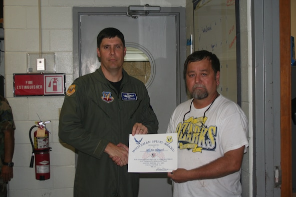 WHITEMAN AIR FORCE BASE, Mo. -- Col. John Robinson, 509th Bomb Wing vice commander, presents the Whiteman Spirit Award to Jim Howard, 509th Civil Engineer Squadron, Aug. 13. (U.S. Air Force photo/Maj. Joe DellaVedova)