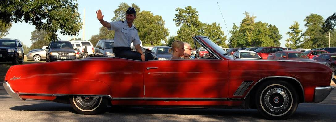 SEDALIA, Mo. - Brig. Gen. Greg Biscone, 509th Bomb Wing commander, rides in a Buick Skylark during a parade at the first day of the 2007 Missouri State Fair Aug. 9. The 2007 Missouri State Fair runs until Aug. 19 at the state fair grounds in Sedalia. (U.S. Air Force photo/Airman 1st Class Stephen Linch)