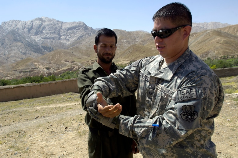 Staff Sgt. Andre Sanchez-Romero demonstrates how to escape from a wrist lock to a member of the Afghan National Police Aug. 6. The security forces Airman, a member of the Panjshir Provincial Reconstruction Team, traveled with other PRT members to the Anaba district of Panjshir Province, Afghanistan, to provide training to ANP working in the district.  Sergeant Sanchez-Romero is deployed from Minot Air Force Base, N.D.  (U.S. Air Force photo/Master Sgt. Jim Varhegyi)