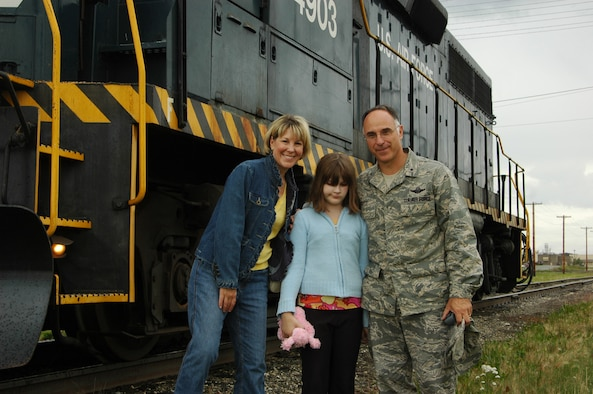 EIELSON AIR FORCE BASE, Alaska--Lisa, Rachel and Brig. Gen. Dave Scott, 354th Fighter Wing commander, pose for a photo after their complimentary train ride Aug. 14 as part of a farewell to General Scott and his family. (U.S. Air Force photo by Tech. Sgt. William Farrow)