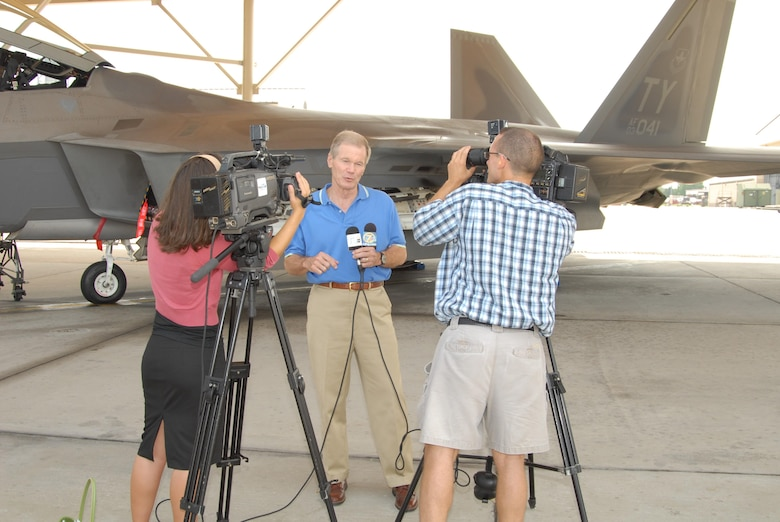 Florida Senator Bill Nelson speaks with local reporters in front of a Tyndall AFB F-22 Raptor during his base tour August 9, 2007.  Senator Nelson visited the base as part of a scheduled Florida panhandle tour.  (USAF photo/Lisa Norman)