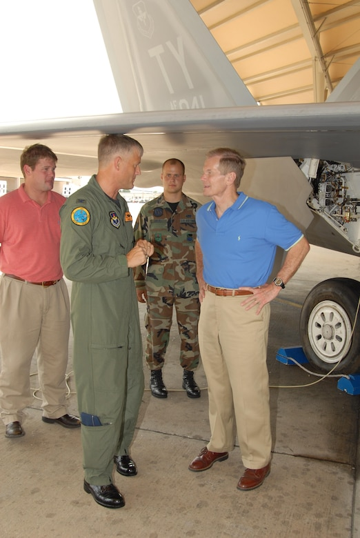 Colonel William H. Mott V, 325th Operations Group commander, briefs Florida Senator Bill Nelson on the F-22 Raptor capabilities during the senator's tour of the base August 9, 2007.  Senator Nelson visited Tyndall as part of a scheduled Florida panhandle tour.  (USAF photo/Lisa Norman)