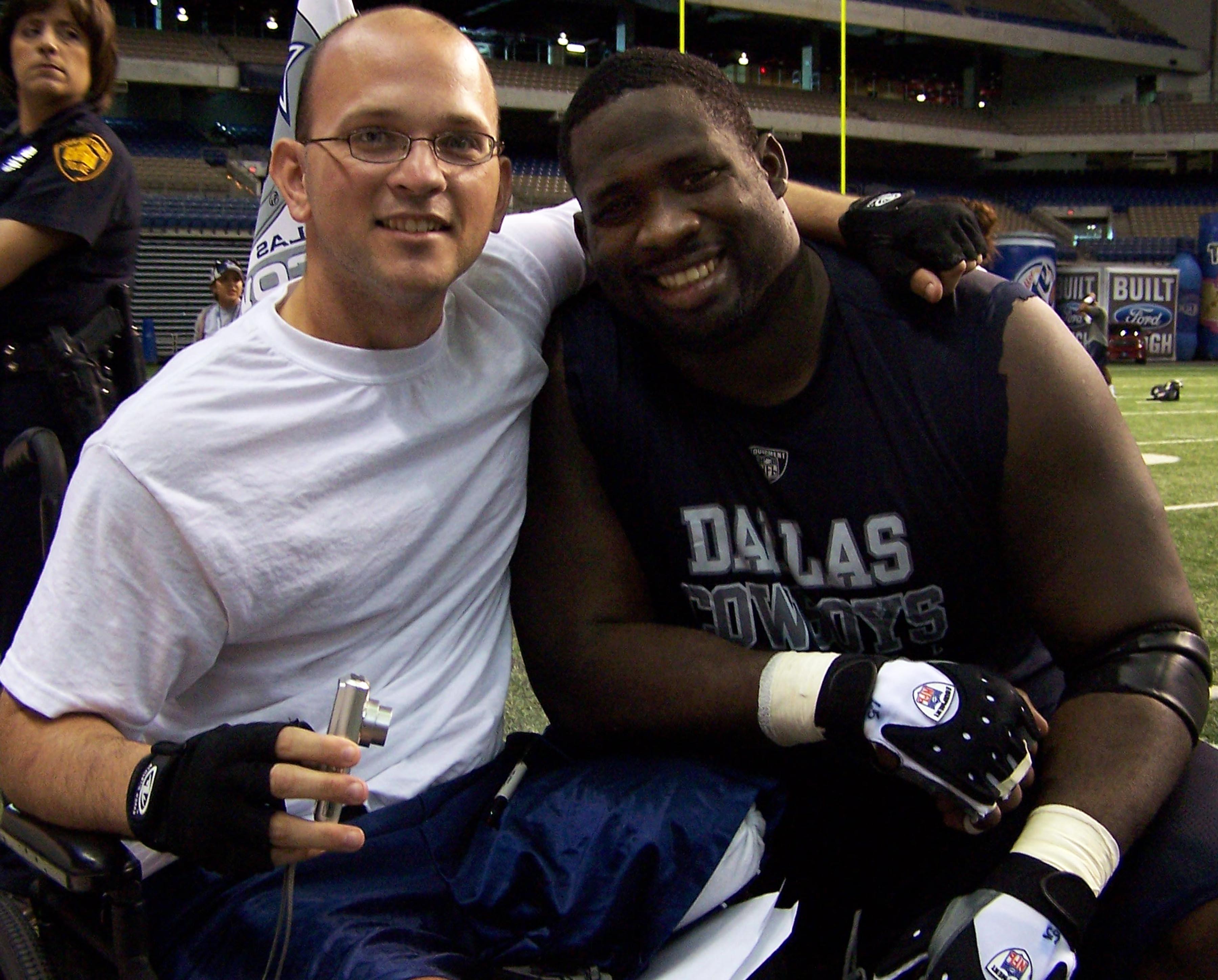 Army Sgt  Daniel Cowart gets a hug from Dallas Cowboys