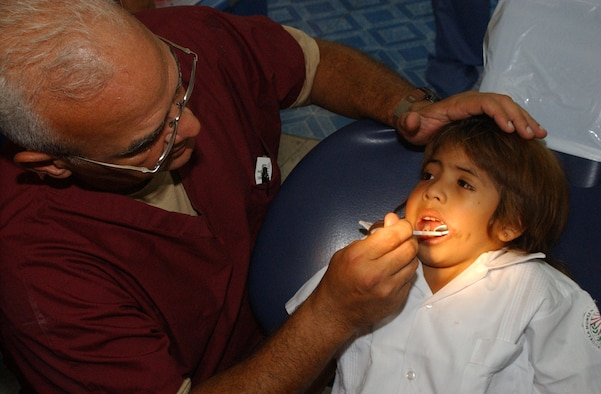 TEGUCIGALPA, Honduras -- Army Lt. Col. (Dr.) Manuel Marien, a pediatric dentist from Fort Hood, Texas, examines the teeth of a Honduran child during a Medical Readiness Training Exercise, or MEDRETE, Aug. 14, 2007.  Soldiers and Airmen are helping hundreds of Honduran children and providing much needed dental care at the Catholic University Dental School here. (US Air Force photo/1st Lt. Erika Yepsen)