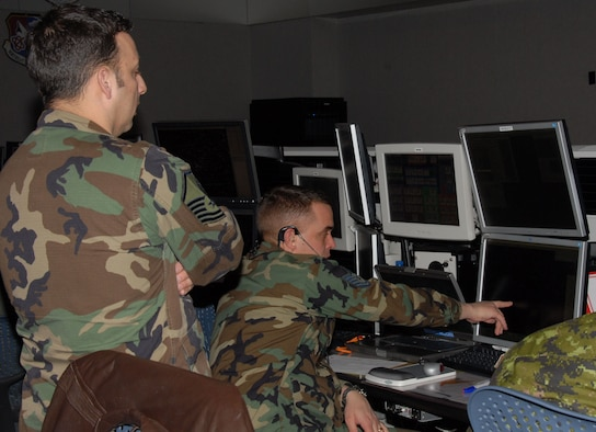 Members from the Northeast Air Defense Sector perform their command and control mission in order to prevent air attacks against the U.S. by responding to unknown, unwanted and unauthorized air activity approaching and operating within U.S. sovereign airspace.  (U.S. Air Force Photo/174th Fighter Wing Visual Information)