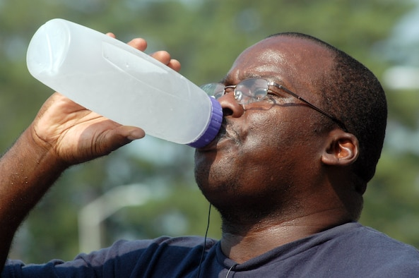 Joey Kornegay hydrates with some water after a morning of outdoor exercise. U. S. Air Force photo by Sue Sapp