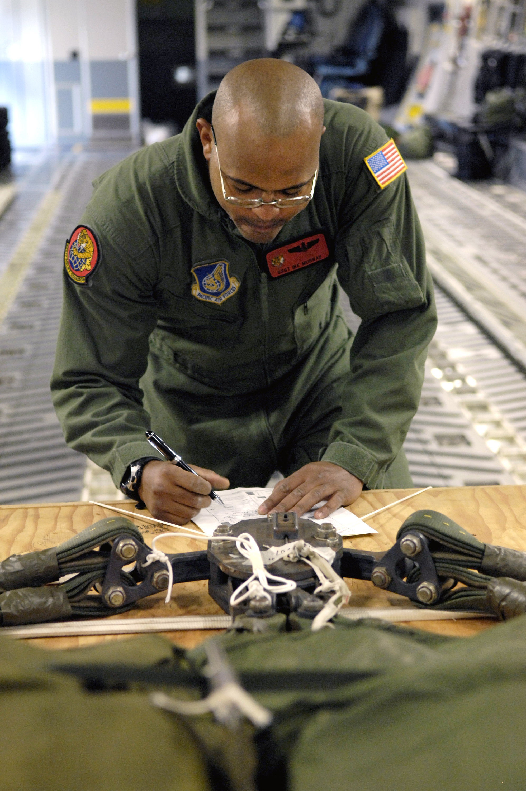 Staff Sgt Ike Murray Goes Over A Joint Airdrop Inspection Checklist Aug  13 At