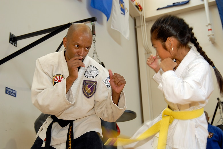 Alonzo Jones spars with one of the students. Martial Arts students and fans gathered at the Los Angeles AFB Fitness Center for a demo of the Cory Jitsu / Comba-tai discipline, Aug. 11.  (Photo by Joe Juarez)