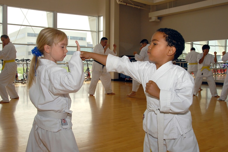 Quentin Evans, 4, and Avianna Raupach, 6, demonstrate their striking technique.  Martial Arts students and fans gathered at the Los Angeles AFB Fitness Center for a demo of the Cory Jitsu / Comba-tai discipline, Aug. 11.  (Photo by Joe Juarez)