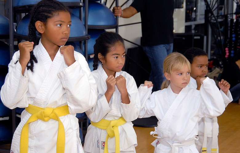Cambria Green, 9, Kimberly Sleeis, 7, Avianna Raupach, 6, and Quentin Evans, 4, demonstrate their stance. Martial Arts students and fans gathered at the Los Angeles AFB Fitness Center for a demo of the Cory Jitsu / Comba-tai discipline, Aug. 11.  (Photo by Joe Juarez)