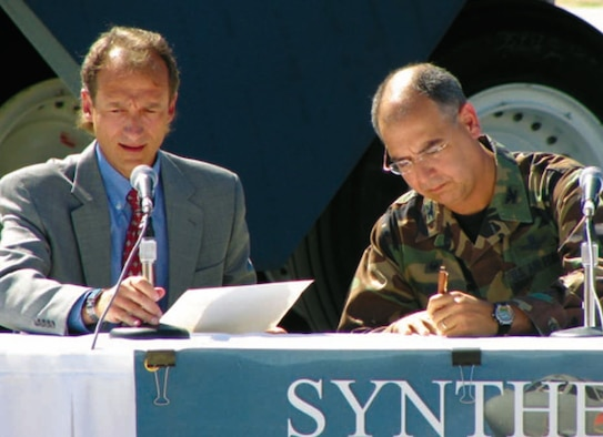 Col. Michael Hirka, 327th Aircraft Sustainment Group commander, signs the certificate certifying Fischer-Tropsch synthetic fuel blends for use in the B-52H Stratofortress as Jerold Smith, chief engineer with the 327th ASG, reads the official document. Air Force photo