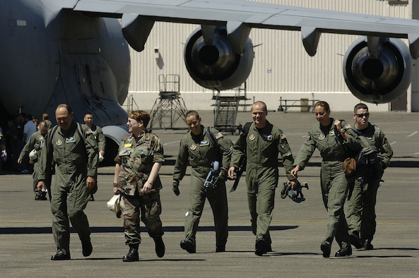 Reserve Airmen from the 446th Aeromedical Evacuation Squadron, McChord Air Force Base, Wash., exit a C-17 at the aeromedical evacuation static configuration event during Air Mobility Rodeo 2007, July 24. The event measured a team's ability to perform aeromedical evacuations in a KC-135 and a C-17. Air Mobility Command's Rodeo 2007 is a readiness competition of U.S. and international mobility air forces. It focuses on improving war fighting capabilities and support of the Global War on Terrorism.   (U. S. Air Force photo/Senior Airman Clay Lancaster)