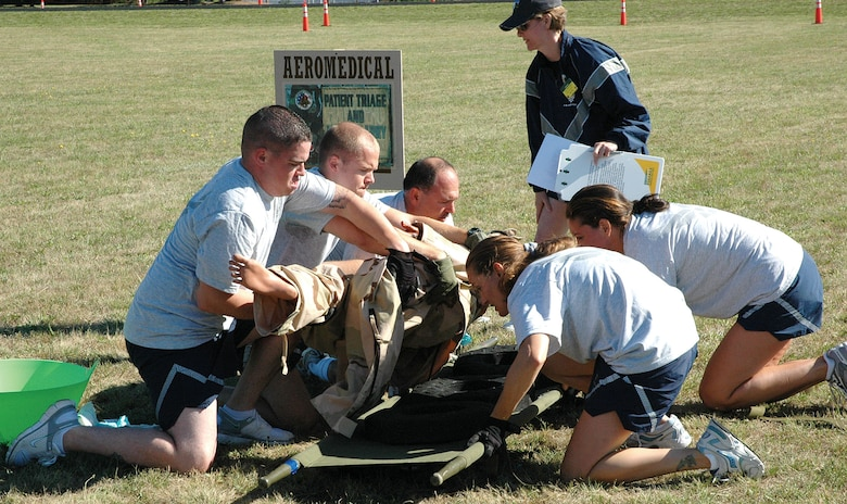 The 446th Aeromedical Evacuation Squadron team moves a mock patieent from the ground to a litter before carryign him through an obstacle course during the AE challenge course at the Rodeo 2007 competition at McChord Air Force Base, Wash., July 23-27. The team wone the Aune Paget Trophy for best aeromedical team and also won the best aeromedical contingency flight award. (U.S. Air Force photo/Capt. Jennifer Gerhardt)