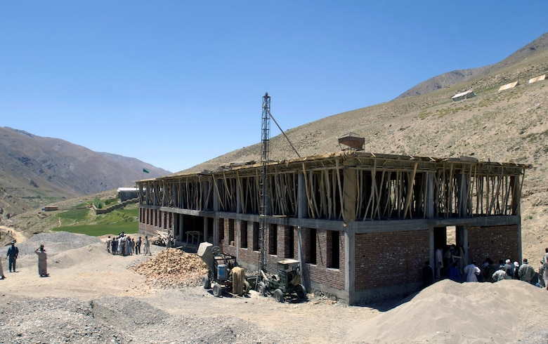 Members of the Panjshir Provincial Reconstruction Team check on the progress of a school construction project Aug. 4 in the Paryan district of Panjshir Province, Afghanistan.  Once completed, the school will accommodate children from several villages in the province. The children are currently attending classes in makeshift tents overlooking the construction site.  The project is one of several being monitored by the PRT.  (U.S. Air Force photo/Master Sgt. Jim Varhegyi)