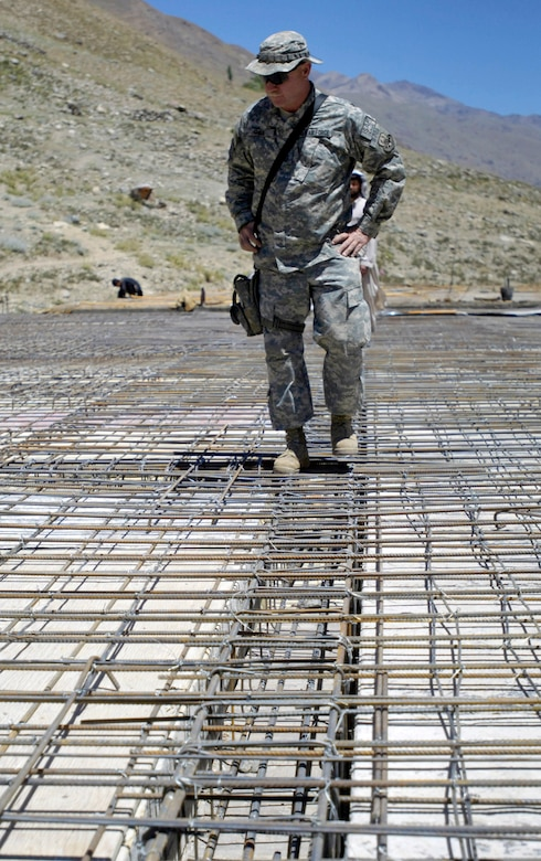 Senior Master Sgt. Roger Smith looks over the rebar grid Aug. 4 which will
