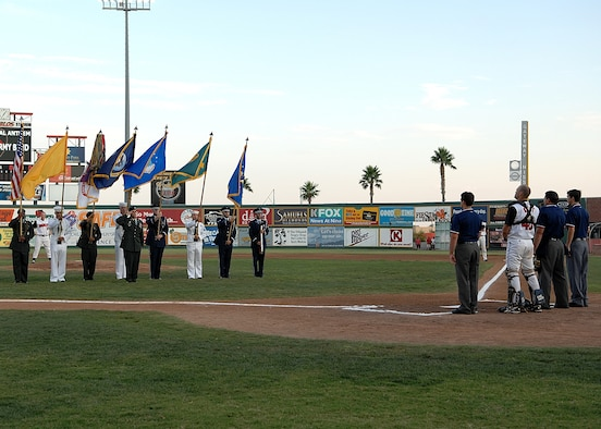 Members of the Holloman Steel Talons Honor Guard Team present the colors along with members of the other branches of military service before the El Paso Diablos military appreciation night Aug. 15. (U.S. Air Force photo/AIrman 1st Class John Strong)