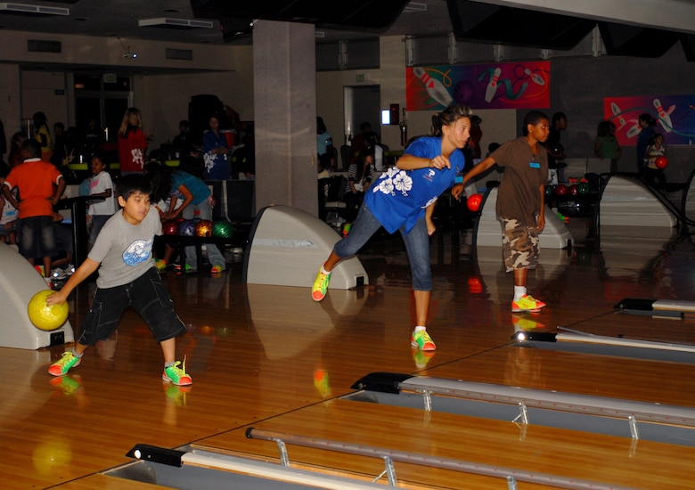 Okinawan children joined their American counterparts for an evening of bowling, games, arts and crafts, food and fun during the Kadena and Chatan Town lock-in cultural exchange Aug. 10. The lock-in began at 8 p.m. and lasted until 8 a.m. the next day and promoted cultural awareness and friendship among the children.  The 18th Services Squadron and Chatan Lion's Club sponsored the event.  (U.S. Air Force photo/Senior Airman Nestor Cruz)