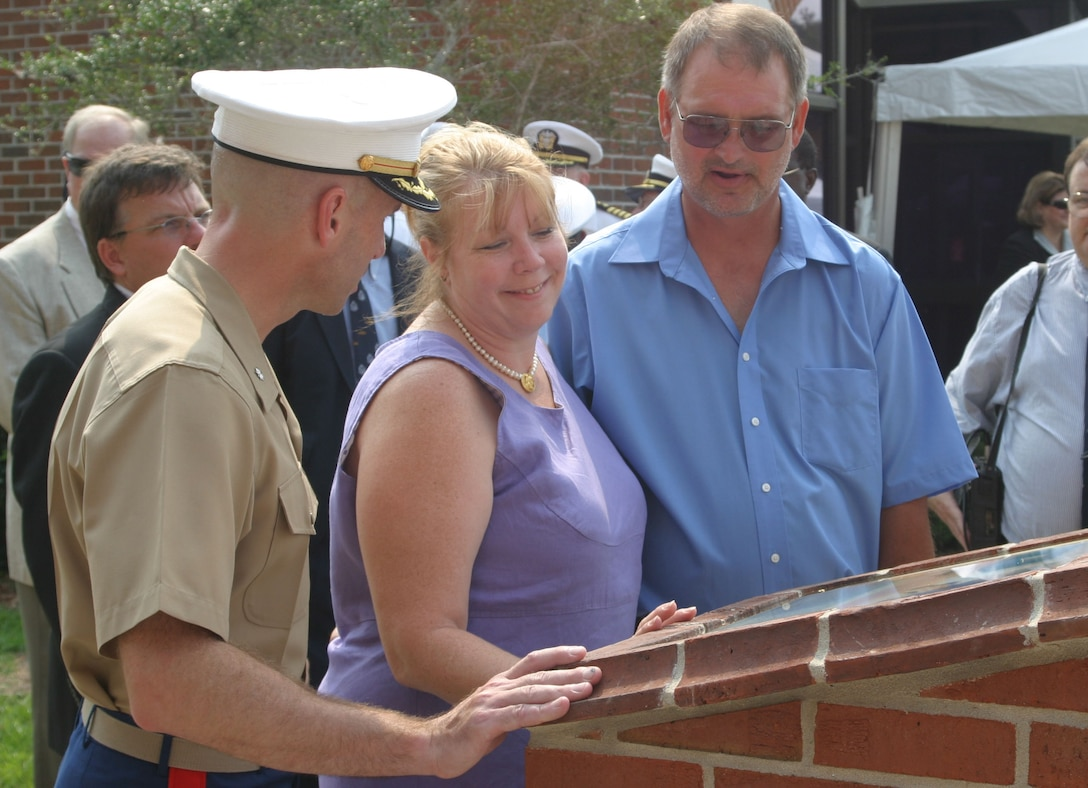 KINGS BAY, Ga. (Aug. 17, 2007)- Lt. Col. Andrew J. Murray (left), commanding officer of Marine Corps Security Force Company, Kings Bay, Ga., speaks to Deb and Dan Dunham, the parents of Cpl. Jason Dunham, a Medal of Honor recipient for Operation Iraqi Freedom, after a barracks dedication ceremony for their son here, Aug. 17. Dunham was stationed here from 2001-2003 before joining 3rd Battalion, 7th Marine Regiment, 1st Marine Division in Twentynine Palms, Calif. Dunham received the Medal of Honor for heroic actions in Karabilah, Iraq, on April 14, 2004. (Official U.S. Marine Corps photo by Cpl. Lucian Friel (RELEASED)
