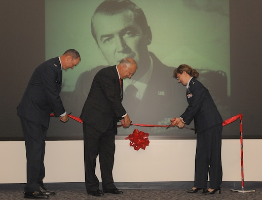 Col. Terry L. Ross (left), 11th Wing vice commander, Carson Green, president of the Jimmy Maitland Stewart Museum and Lt. Col. Diane Jones, 11th Mission Support Squadron commander, cut the ribbon at the Jimmy Stewart Theater dedication ceremony at Building 52 on Bolling Aug. 13. The theater is named after Brig. Gen. James Stewart who enlisted in the Army Air Corps in 1941 and rose to the rank of colonel in four years. At the time of his enlistment Mr. Stewart was a famous actor with an Academy Award to his name. (U. S. Air Force photo by Airman First Class Tim Chacon)