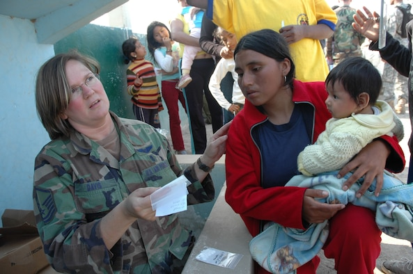 PISCO, Peru -- Air Force Master Sgt. Deborah Davis, task force NCOIC for the humanitarian mission here, explains a prescription to a patient at the medical site established by task force members. At the site, medical personnel provide basic medical care and medicines to those suffering following the 8.0 magnitude earthquake that devastated the region Aug. 15. The medical team treated more than 500 people during the first two days of the mission. (U.S. Army photo by Spec. Grant Vaught)