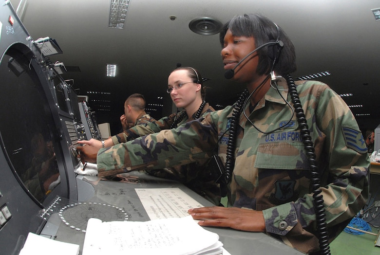 Staff Sgt. Crystal Sheffield (right) and Airman 1st Class Amber Hoedebeck control a mission by using a Base Air Defense Ground Environment system at Naha Air Base, Japan. They are weapons directors with the 623rd Air Control Flight. (U.S. Air Force photo/Staff Sgt. Steven Nabor)