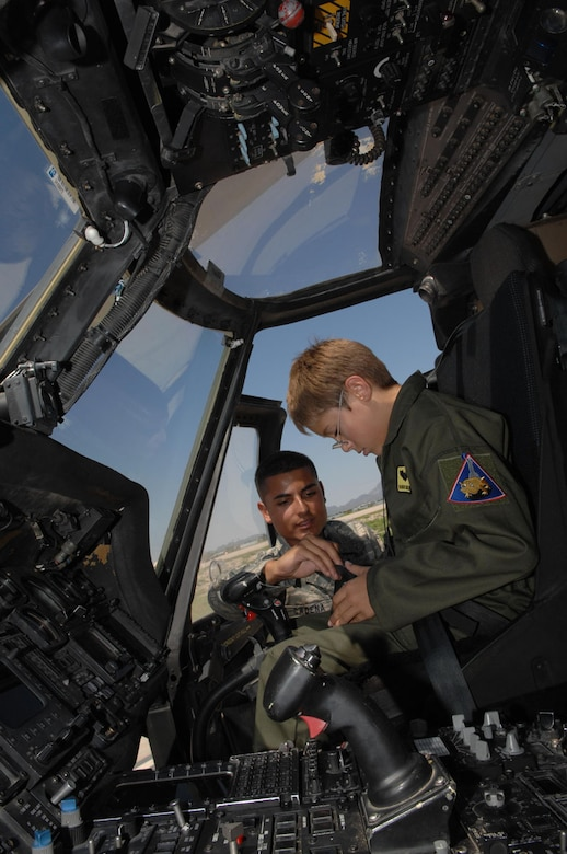 Airman 1st Class Mark Cadena, 563rd Maintenance Squadron, shows 10-year-old Brandon Smalling the different aspects of a HH-60 Pavehawk, Thursday August 10 at Davis-Monthan AFB, Ariz as part of the Pilot for a Day program. The program is designed to help children with disabilities or serious illnesses to enjoy a day focused on them and their interest in aviation. Activities in the program include; trying on life support equipment, using Night Vision goggles, flying an A-10 simulator, and seeing aircraft up close.(U.S. Air Force photo/Senior Airman Christina D. Kinsey)