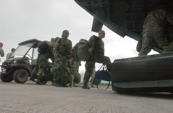 Soldiers and Airmen from Joint Task Force-Bravo here board an awaiting helicopter for the flight to Belize.  Approximately 25 Airmen and Soldiers from Soto Cano Air Base left Honduras to assess the damage caused by Hurricane Dean in Belize and assist Belize in recovery efforts.  U.S. Air Force photo by Martin Chahin.
