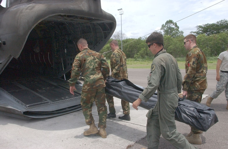 SOTO CANO AIR BASE, Honduras - Members of the 1st Battalion 228th Aviation Regiment here load equipment onto a CH-47 Chinook helicopter Aug. 21.  Approximately 25 Airmen and Soldiers from Soto Cano Air Base left Honduras to assess the damage caused by Hurricane Dean in Belize and assist Belize in recovery efforts.  U.S. Air Force photo by Martin Chahin.