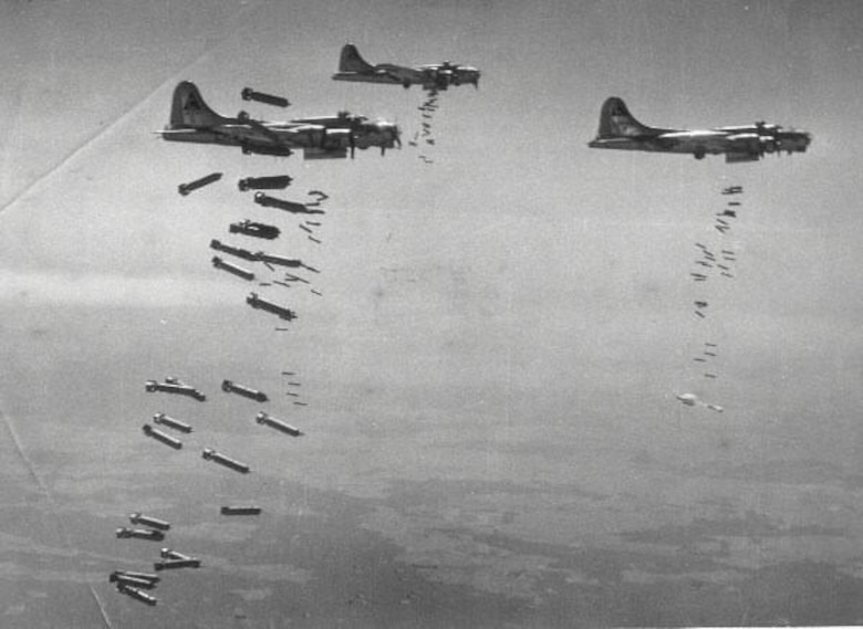 A formation of B-17 Flying Fortresses conducts a daylight bombing raid over German-held territory during World War II.  Many of the aircrew members on aircraft shot down during the war ended up in German prisoner of war camps like Stalag Luft III in what is now Poland.  The 442nd Fighter Wing public Web site will feature a series of stories about the experiences of some of these American Airmen.  The four-part series will be added to each month and will be posted in its own section on the site's home page.  (U.S. Air Force photo)