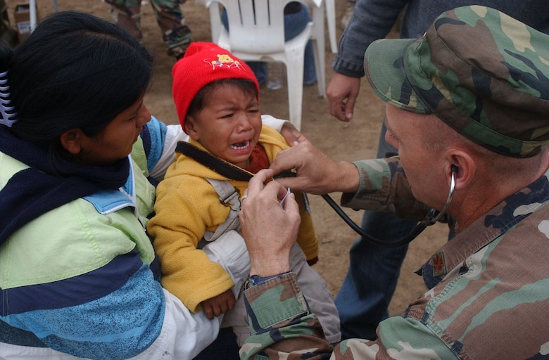 PISCO, Peru - Maj. Joseph Hallock, Joint Task Force-Bravo Medical Element pediatric nurse practitioner, checks the heartbeat of one of the patients at the medical relief site in Pisco, Peru. During the three-day mission, medical personnel provided care to more than 1,500 men, women and children. The task force deployed from Soto Cano Air Base Honduras, Aug. 17 to provide medical care to the people of Pisco following an 8.0 magnitude earthquake that devastated the region. (U.S. Air Force photo by Senior Airman Shaun Emery)